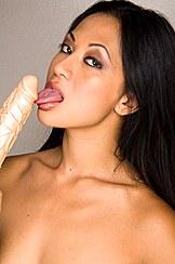 Licking Dildo Head Oriental Eyes Bare Shoulders