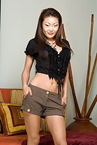 lucy lee wearing shorts black top hands in pockets