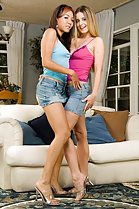 keeani lei denice k standing together wearing denim skirts