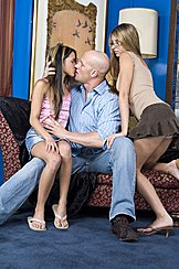 Kitty Veronica Stone On Couch With Guy Kissing Kitty